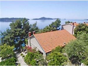 Apartmani Edo Južnodalmatinski otoci, Kvadratura 92,00 m2, Zračna udaljenost od mora 20 m