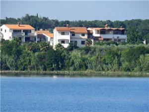 Apartmani i Sobe Ana Pomer, Kvadratura 15,00 m2, Zračna udaljenost od centra mjesta 300 m