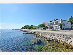 Apartament Ivan Novalja - wyspa Pag, Powierzchnia 50,00 m2, Odległość do morze mierzona drogą powietrzną wynosi 50 m, Odległość od centrum miasta, przez powietrze jest mierzona 300 m