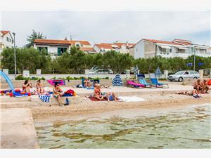 Beachfront accommodation Sibenik Riviera,Book Lada From 74 €