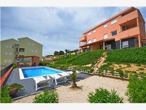 Apartmány Božica Vlasici - ostrov Pag, Rozloha 49,00 m2, Ubytovanie sbazénom, Vzdušná vzdialenosť od mora 70 m