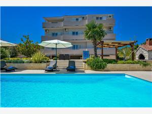 Appartementen Villa Ana Kukljica, Kwadratuur 40,00 m2, Accommodatie met zwembad, Lucht afstand naar het centrum 200 m
