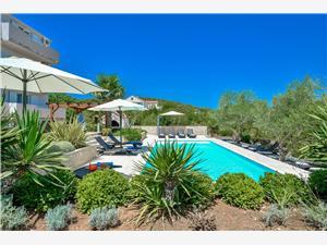 Apartmani Villa Ana Kukljica, Kvadratura 40,00 m2, Smještaj s bazenom, Zračna udaljenost od centra mjesta 200 m