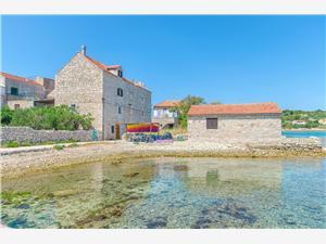 Appartementen Vedrana Noord-Dalmatische eilanden, Stenen huize, Kwadratuur 30,00 m2, Lucht afstand tot de zee 10 m