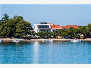 Apartmány Punta Sukosan (Zadar), Rozloha 130,00 m2, Vzdušná vzdialenosť od mora 5 m