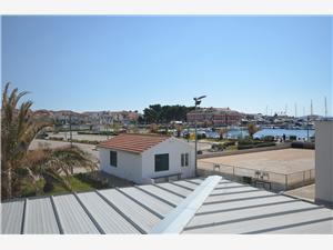 Апартамент LUCIA Tribunj, квадратура 65,00 m2, Воздуха удалённость от моря 200 m, Воздух расстояние до центра города 20 m