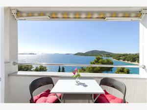Апартаменты Vlasta Tribunj, квадратура 27,00 m2, Воздуха удалённость от моря 100 m, Воздух расстояние до центра города 100 m
