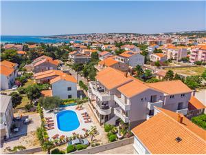 Apartamenty Dorotea Novalja - wyspa Pag, Powierzchnia 40,00 m2, Kwatery z basenem, Odległość od centrum miasta, przez powietrze jest mierzona 900 m