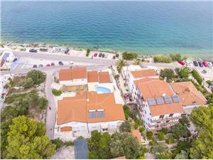 Apartmani Krusica Arbanija (Čiovo), Kvadratura 40,00 m2, Smještaj s bazenom, Zračna udaljenost od mora 30 m