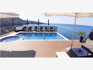 Ferienwohnung und Zimmer Lux Beciragic Montenegrinische Küste, Größe 71,00 m2, Privatunterkunft mit Pool, Luftlinie bis zum Meer 10 m